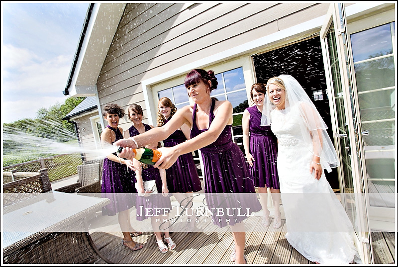 Bride and Bridesmaids popping champagne
