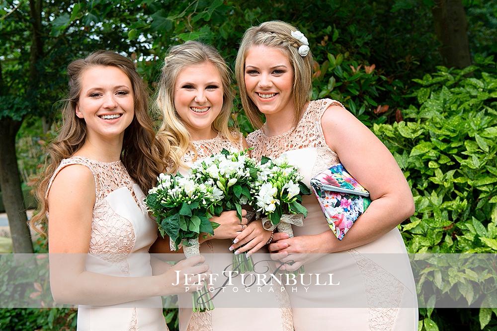 Three Bridesmaids with Flowers