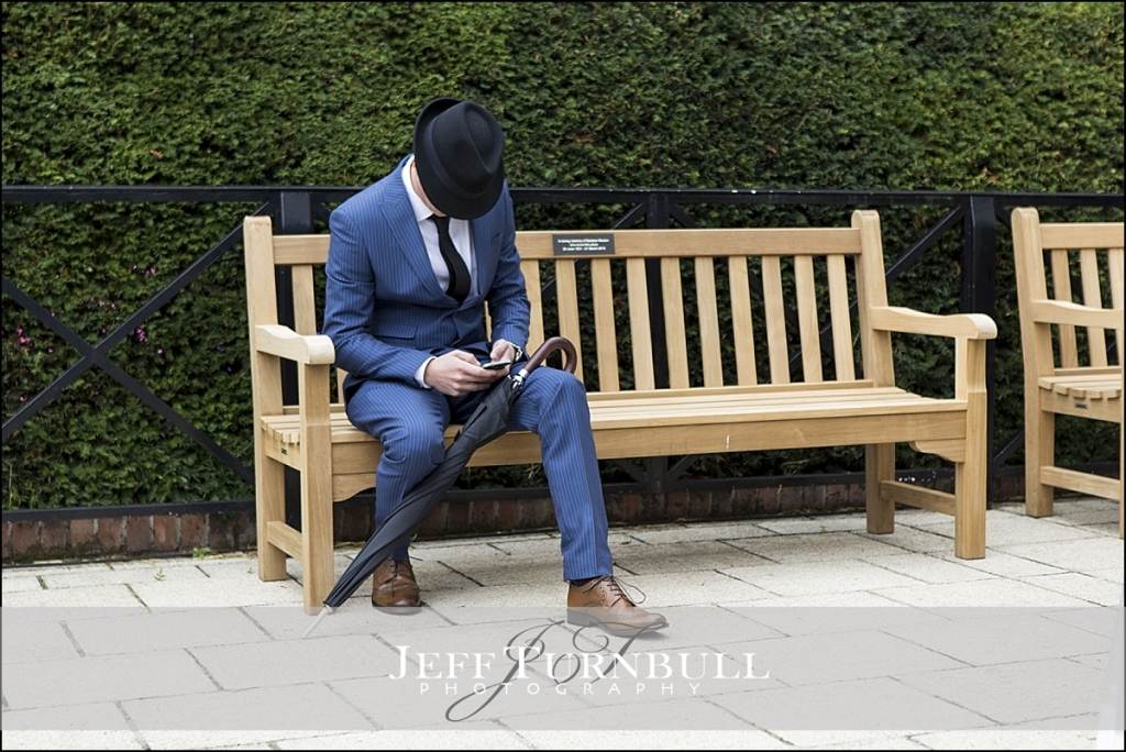 Man in bowler had sitting a on a bench
