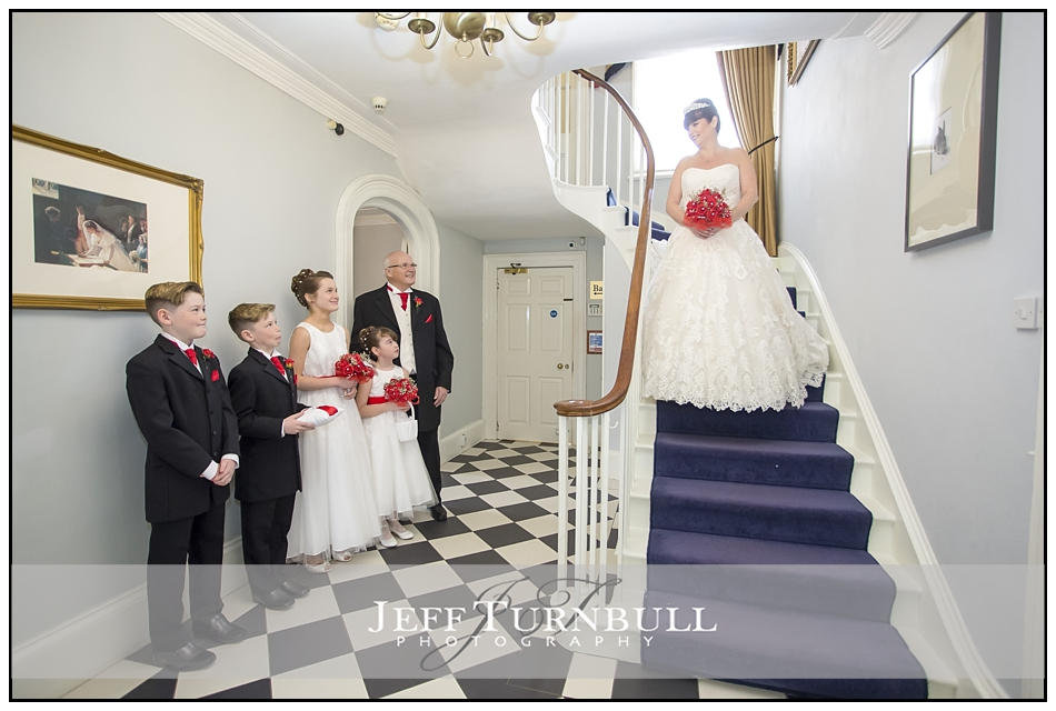 Bride on a sweeping staircase