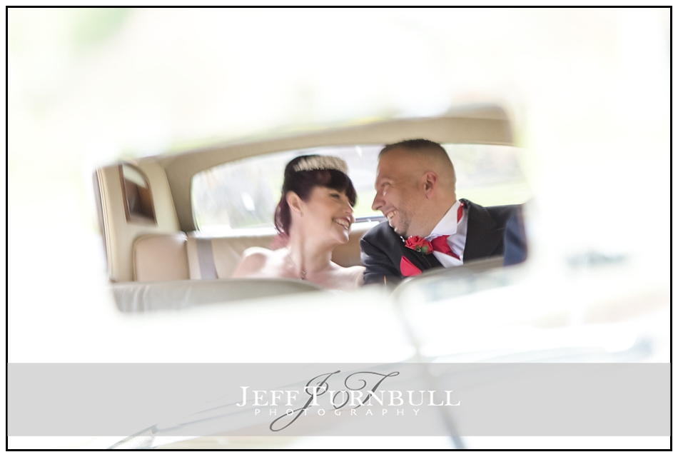 Bride and Groom in rear view mirror