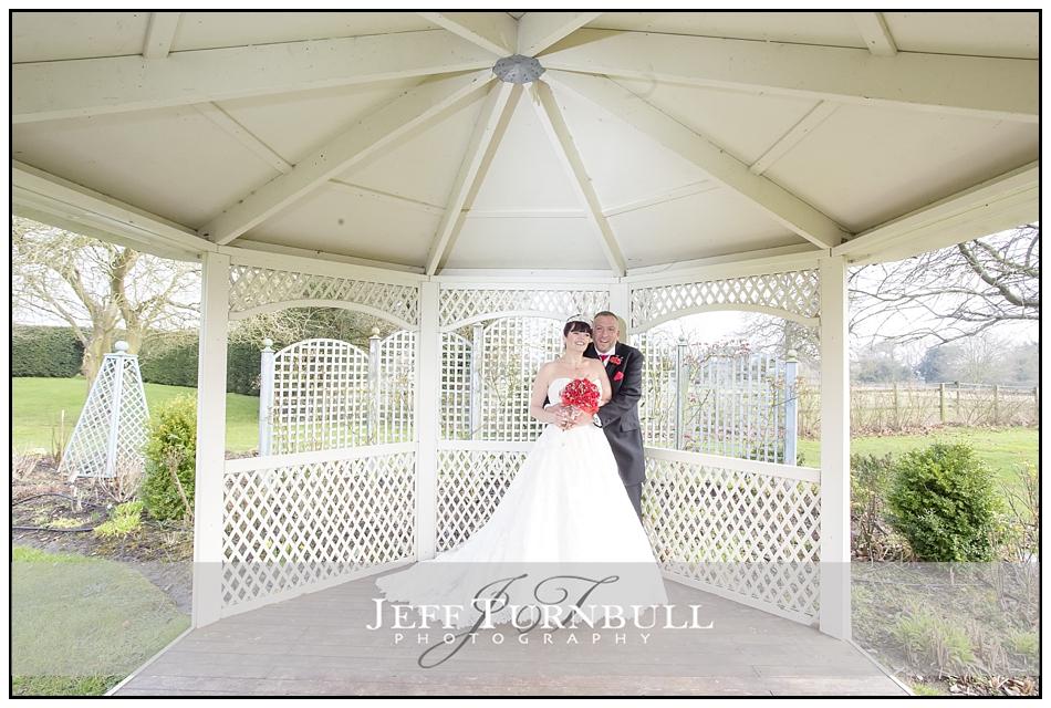 Bride Groom in a gazebo