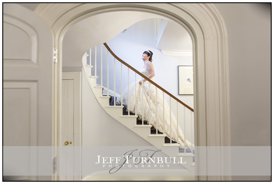 Bride walking up stairs at the Fennes Wedding venue