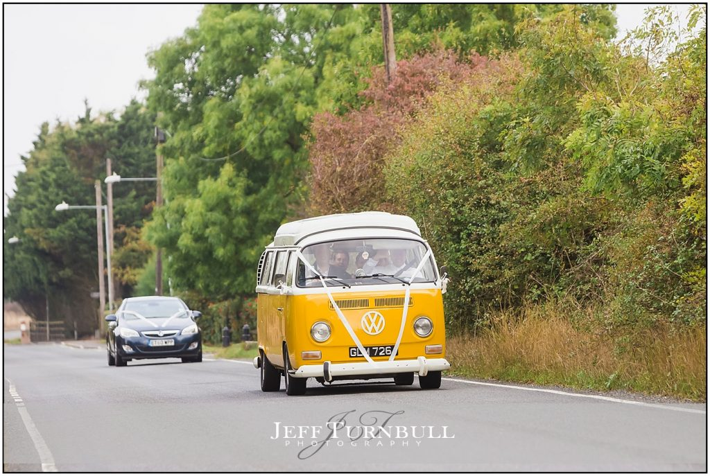 Groom Arriving in VW Camper