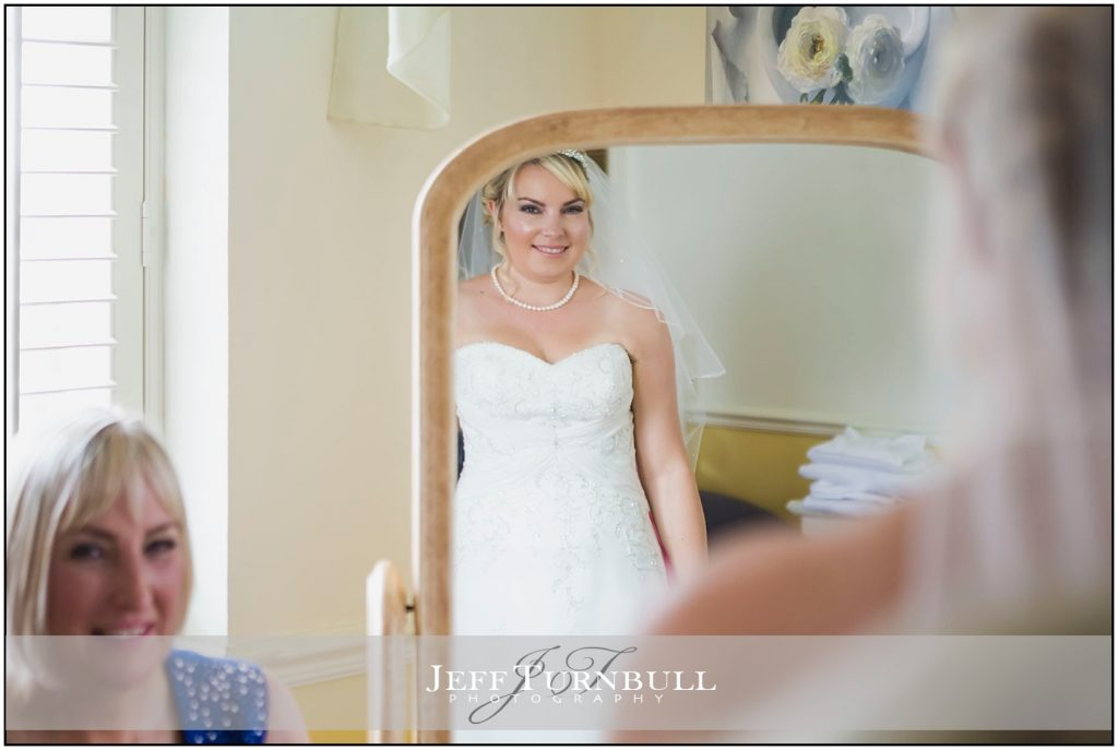 Bride Looking in Mirror Friern Manor