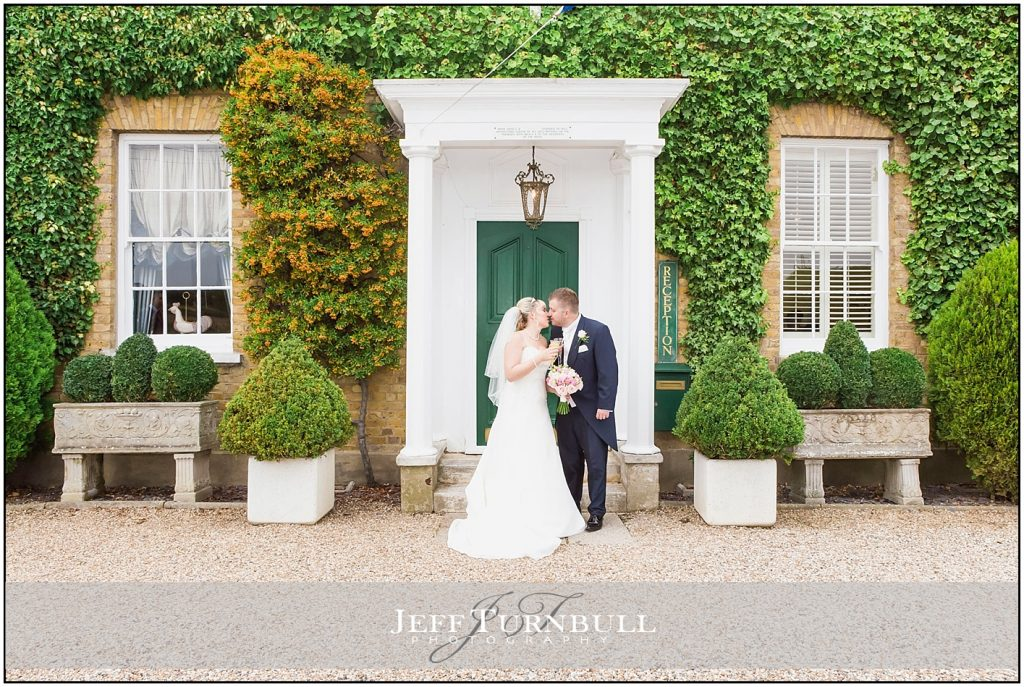 Bride and Groom Standing Front of Friern Manor