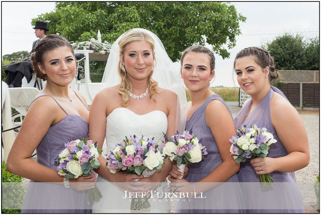 Bride Bridesmaids outside Compasses at Pattiswick