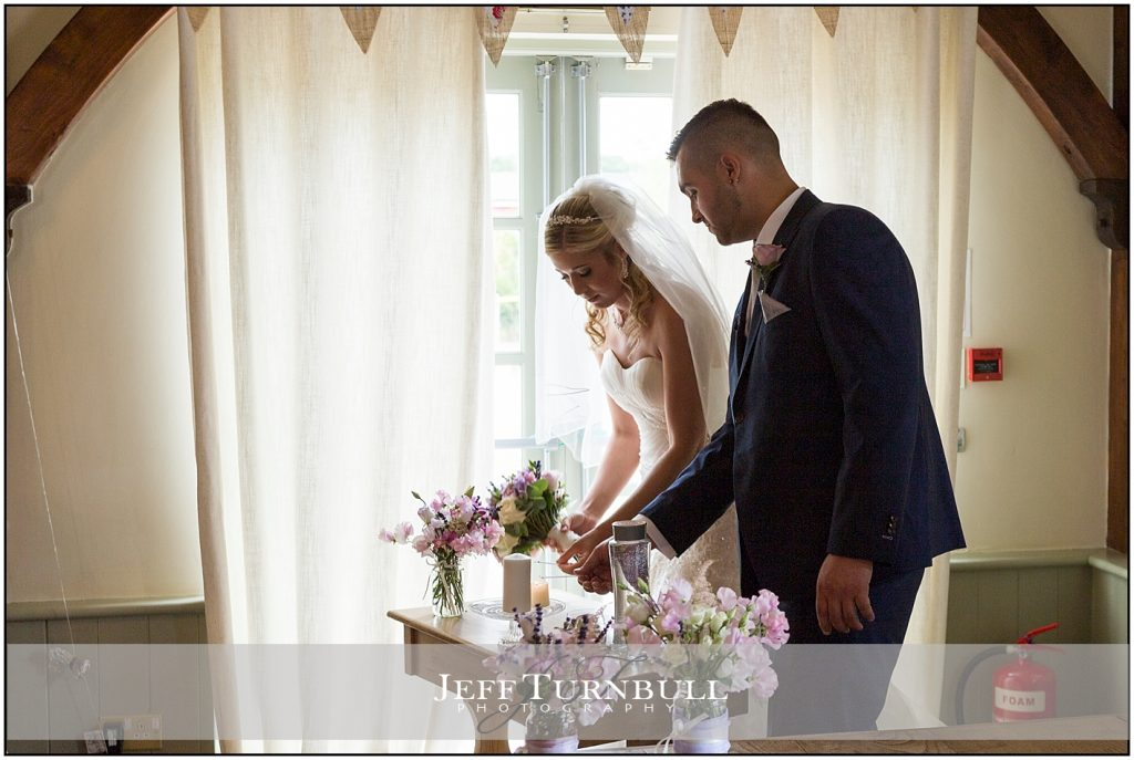 Bride Groom Lighting Candle Compasses at Pattiswick