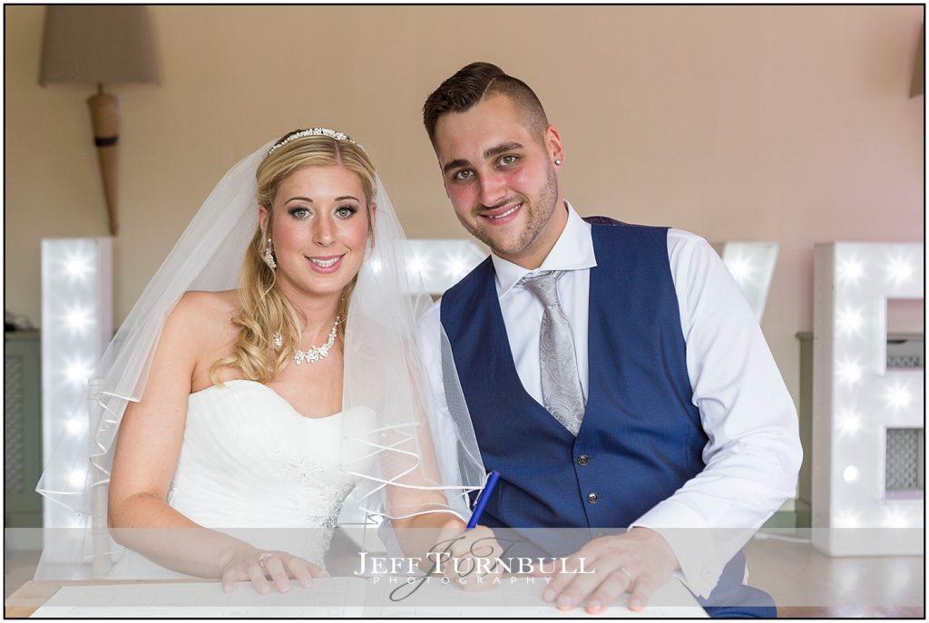 Bride Groom Love Sign Compasses at Pattiswick