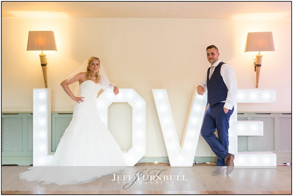 Bride Groom Love Sign Compasses at Pattiswick