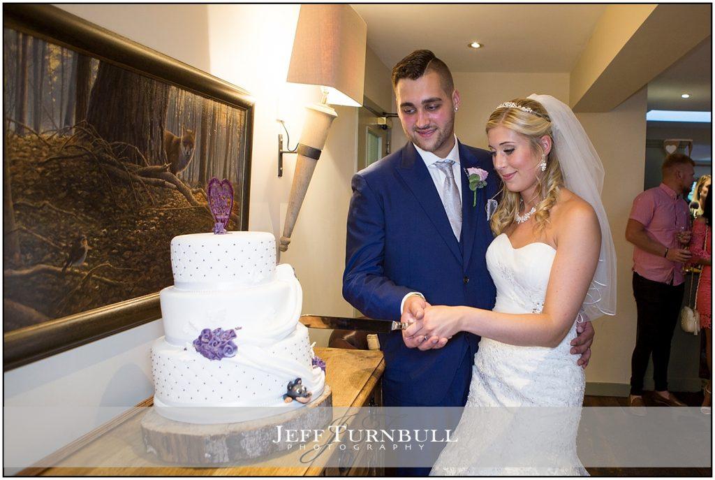 Bride Groom Cutting Wedding Cake Compasses at Pattiswick