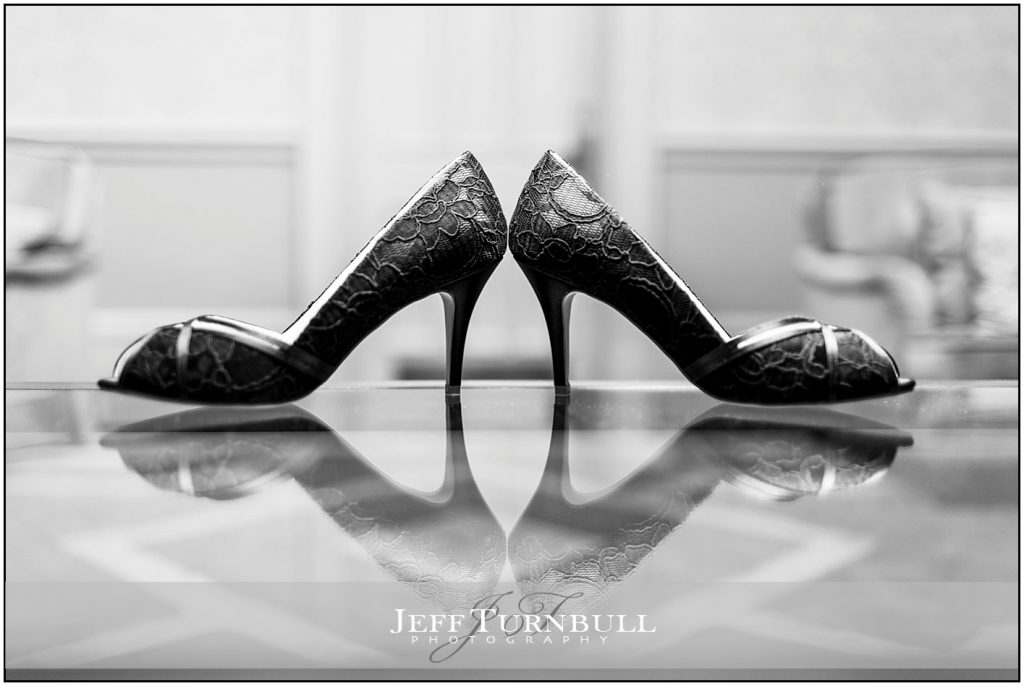 Brides Shoes on Glass Table