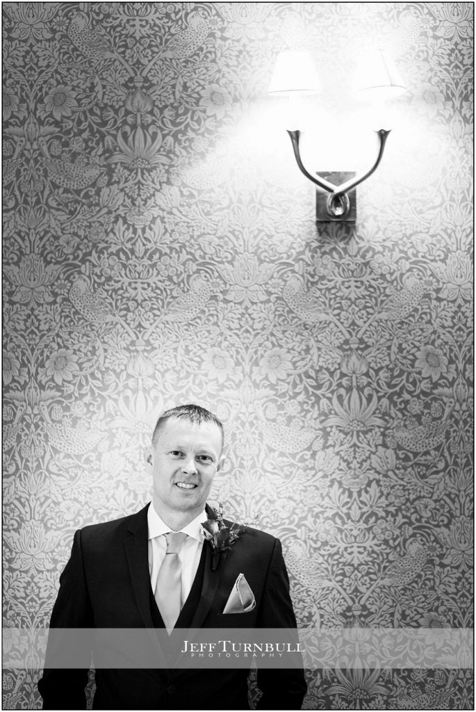 Groom in Front Of Wallpaper at Down Hall