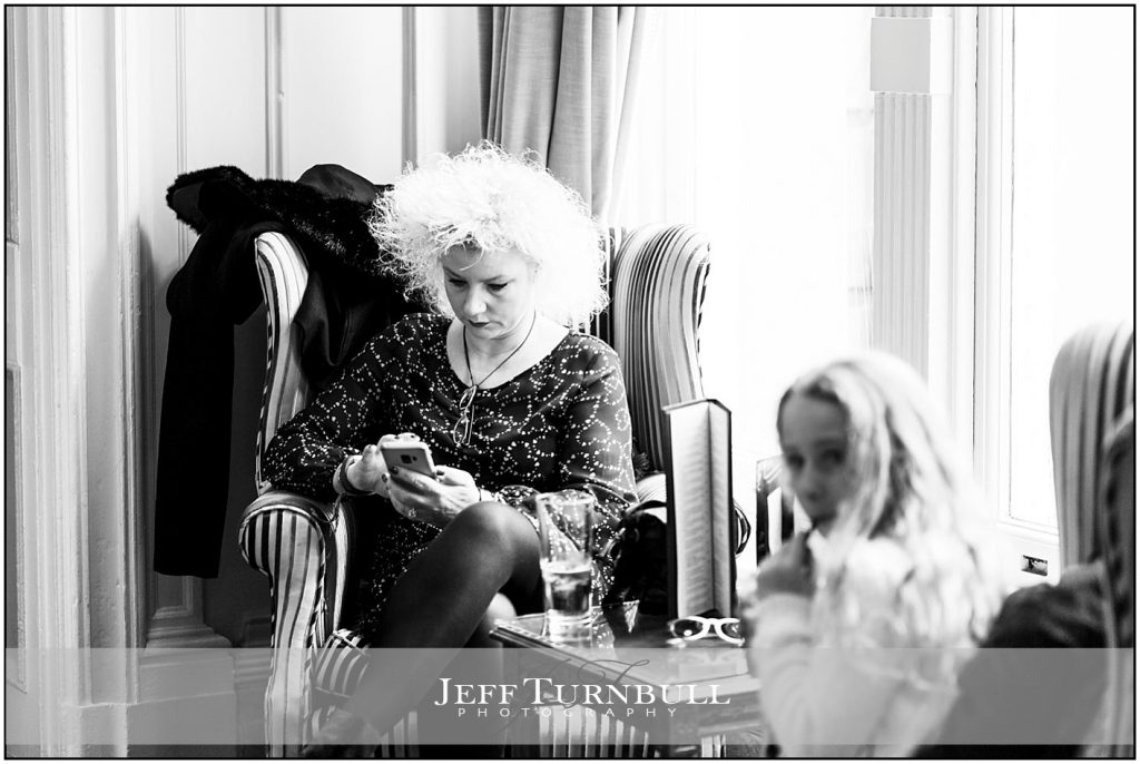 Guest Playing on Her Mobile Phone at Down Hall
