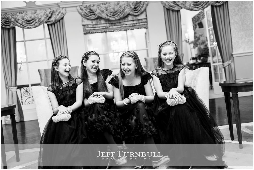 Young Bridesmaids Laughing Sitting on Couch at Down Hall