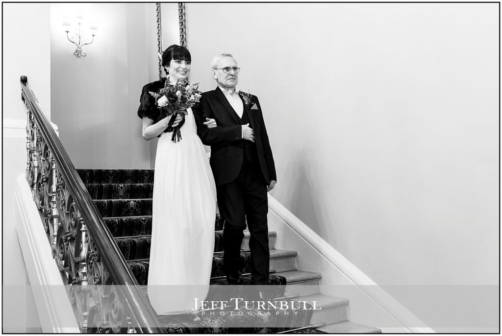 Bride and Father Standing on the Stairs
