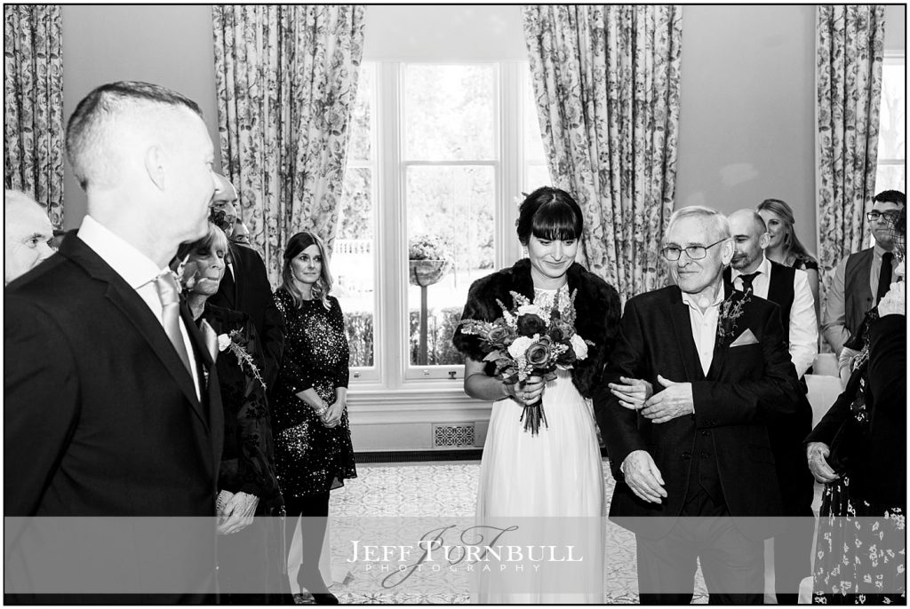 Bride Walking Down Aisle Down Hall Wedding