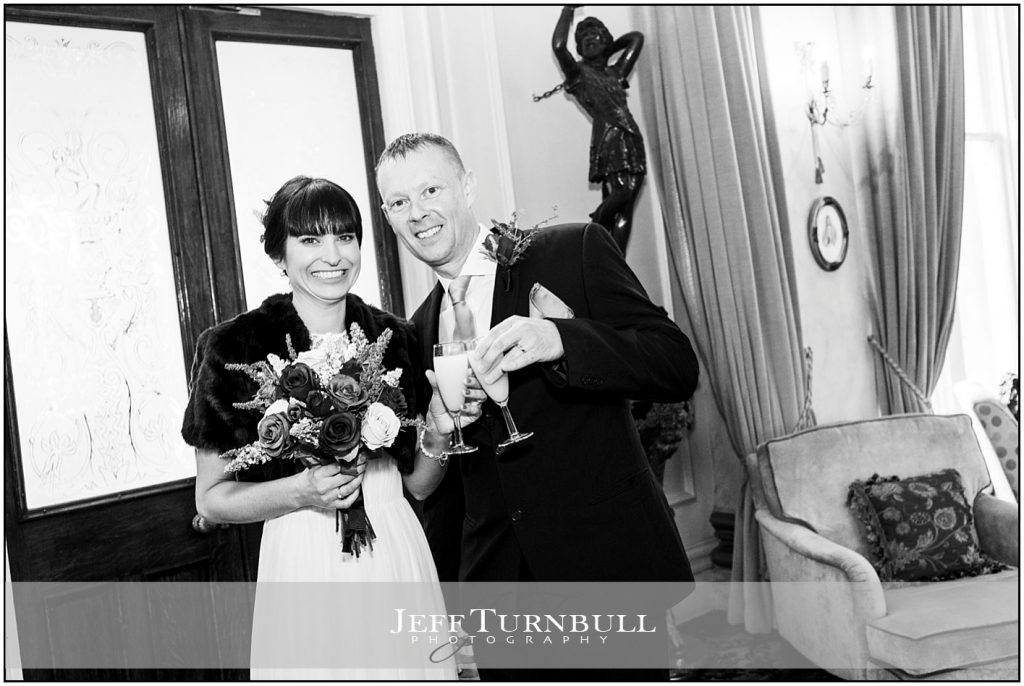 Bride and Groom Drinking Champagne at Down Hall