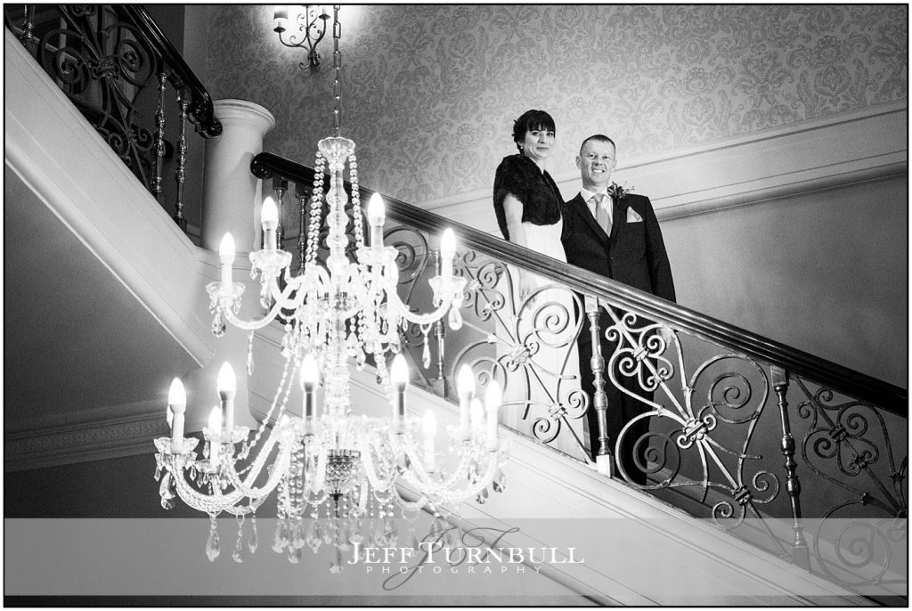 Bride and Groom on Stairs at Down Hall