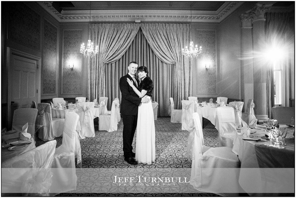 Bride and Groom in Wedding Breakfast room at Down Hall