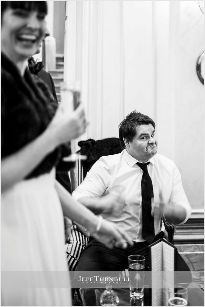 Bride Laughing at Guest at Down Hall Wedding