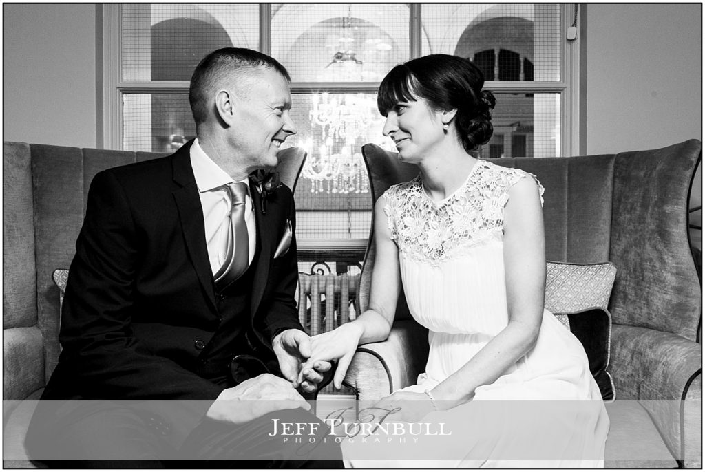 Bride and Groom Sitting Together at Down Hall