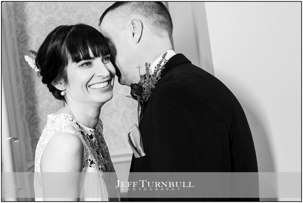 Groom Whispers to Bride at Down Hall