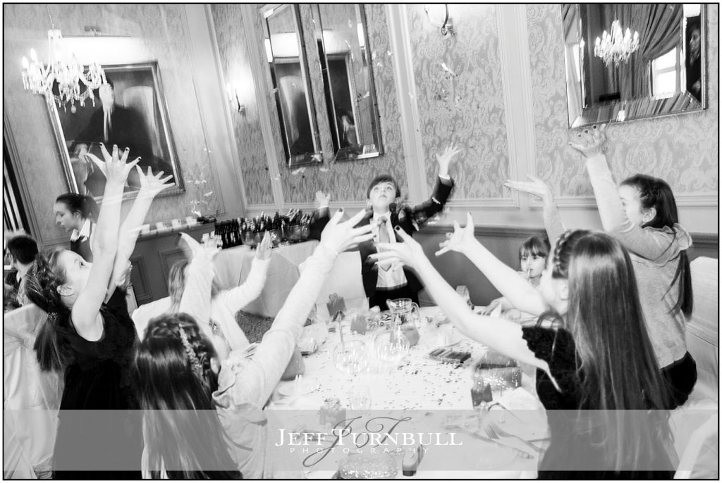Bridesmaids and Pageboy throwing confetti in the Air