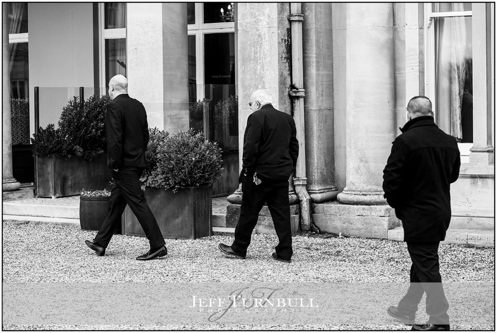 Three Men Walking at Down Hall Wedding