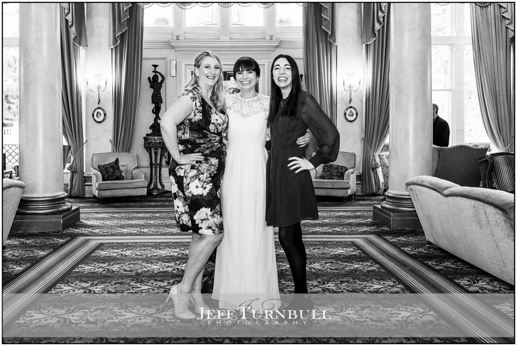 Bride with Friends Down Hall Wedding