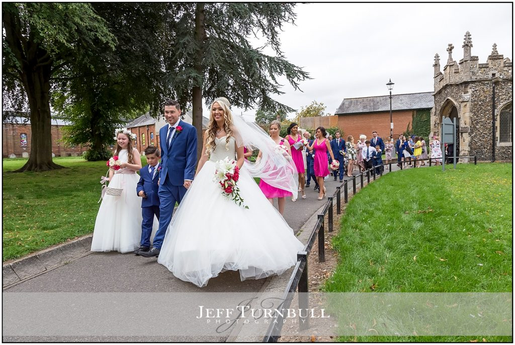 Bride and Groom Leading Guests out of Church
