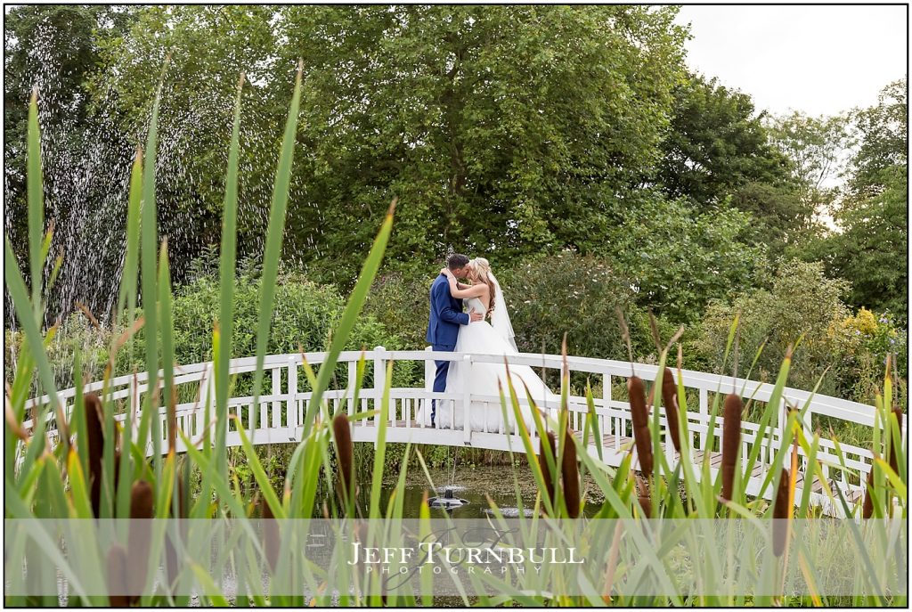 Bride and Groom on the Bridge at the Fennes
