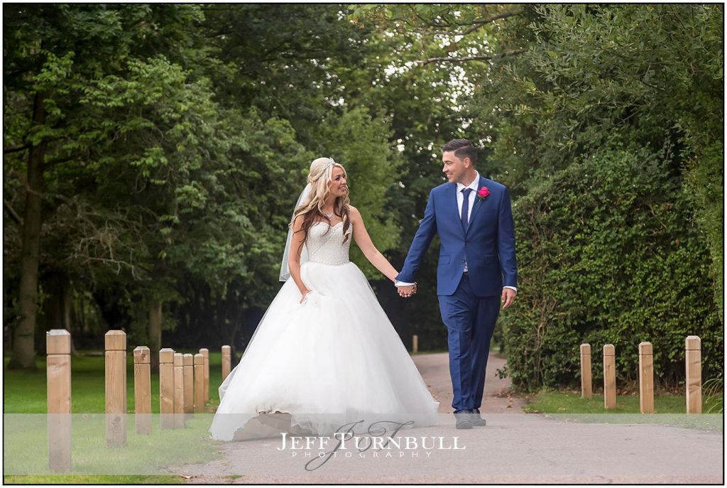 Bride and Groom walking at The Fennes