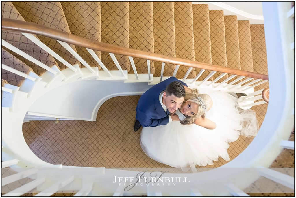 Stairway Photo of Bride and Groom Wedding at The Fennes