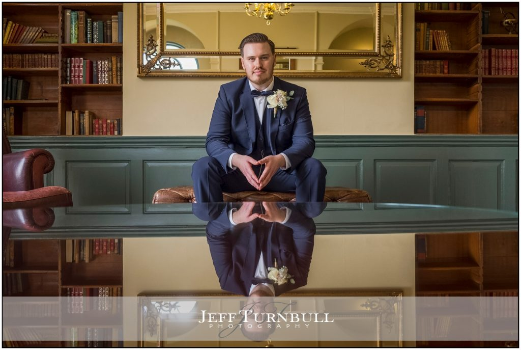 Groom in Table Reflection