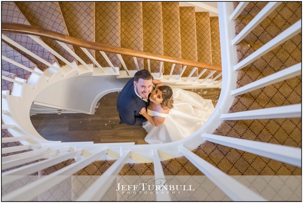 Bride and Groom Botton of Stairs