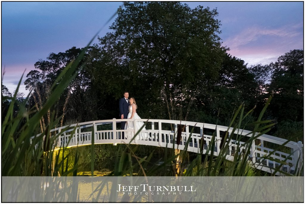 Bride and Groom Nighttime on White Bridge at Fennes