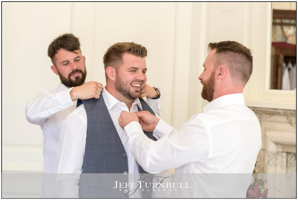 Best men Helping Groom Get Ready