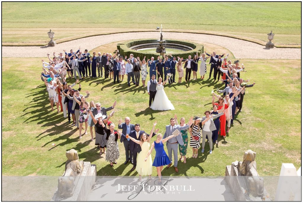Heart Shape Wedding Group Photograph