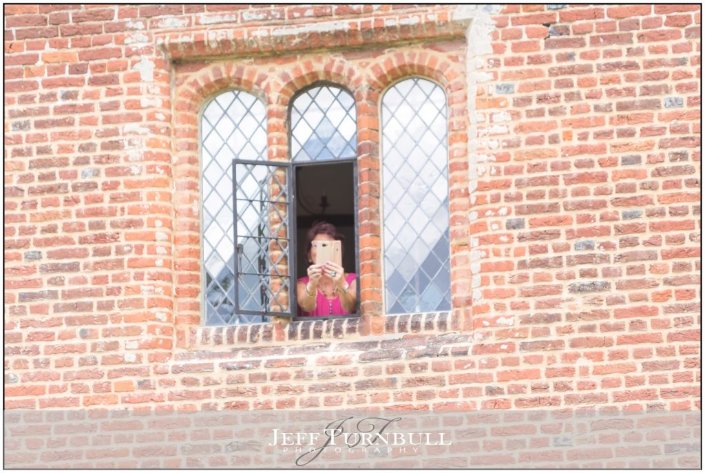 Wedding Guest Leaning Out Window
