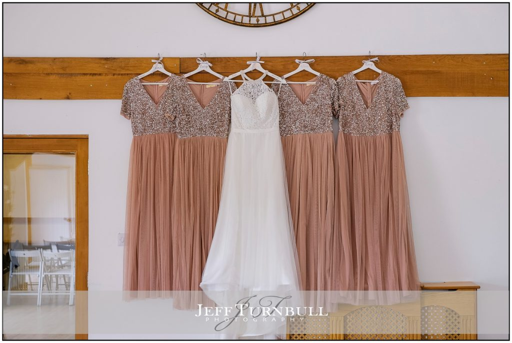 Bride and Bridesmaids Dresses Hanging Up