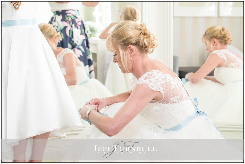 Bride Dressing Flower Girl