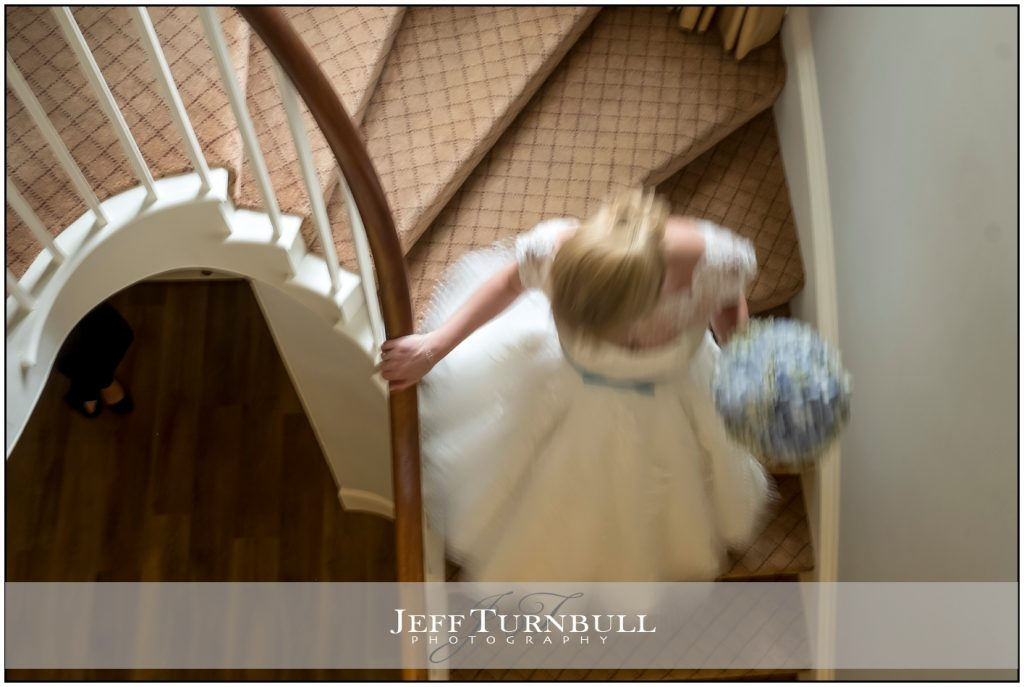 Bride rushing downstairs