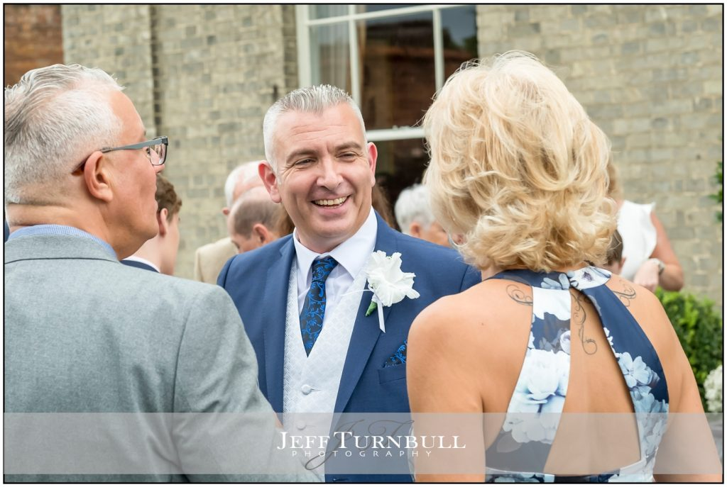 Happy Groom with Guests