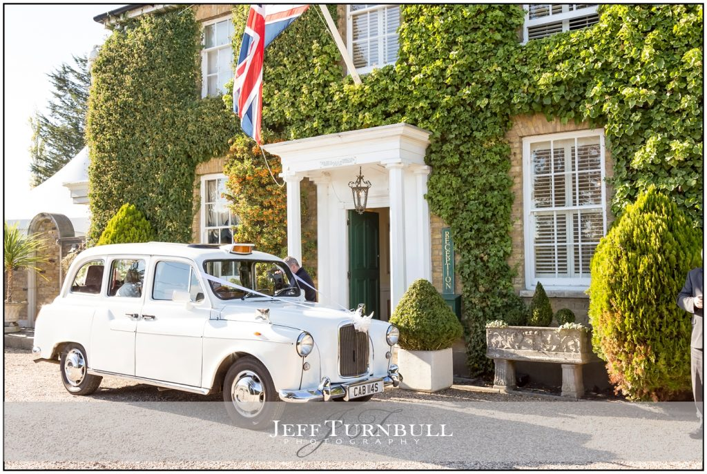 White Taxi outside Friern Manor
