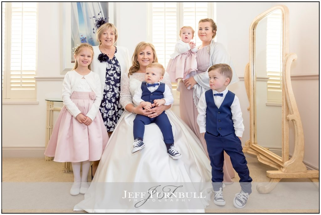 Bride with flower girls and pageboys
