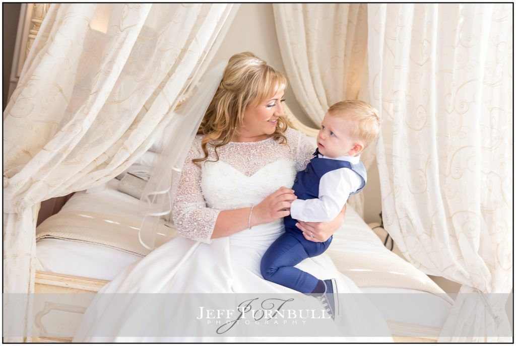 Bride holding rer young son
