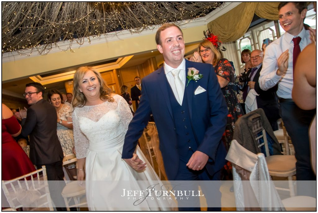 Bride and Groom walking holding hands