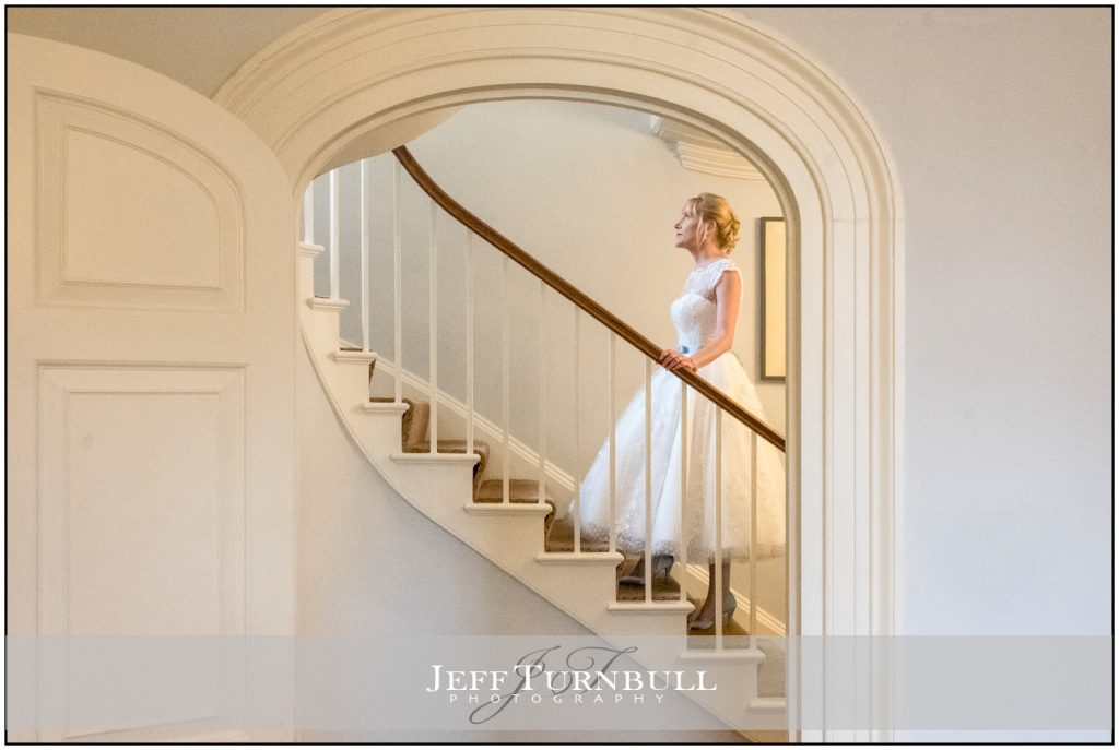 Bride walking up the stairs
