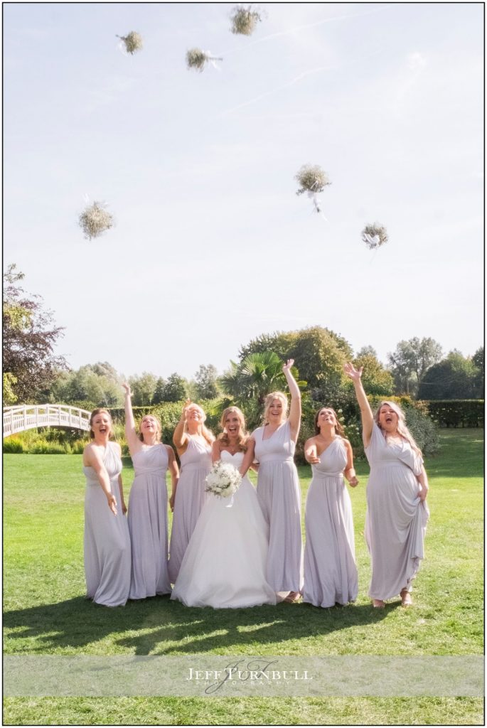 Bridesmaids throwing up their bouquets